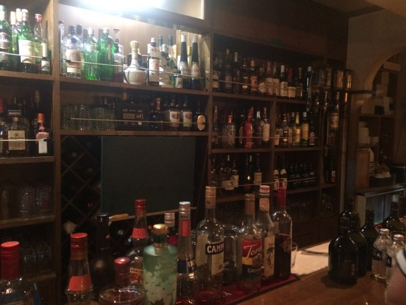 <p>Only a portion of the drinks available behind the bar.</p>