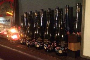 Old bottles lined up for display.