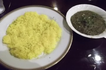 Spinach and mushroom curry with turmeric rice