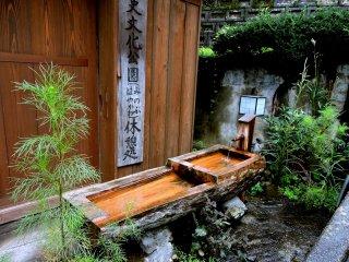 Drinking water outside Kikuya Inn