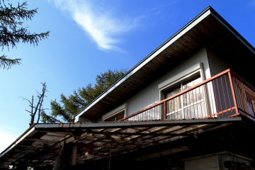 <p>Two rooms viewed from the outside looking towards Mount Fuji</p>