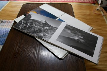 <p>When it gets dark and the view of Mount Fuji disappears, you can continue inside browsing one of the photo books</p>