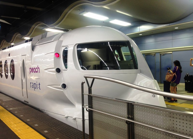 The special white edition of the Nankai Rapit Limited Express with Peach Airways colors.Kintetsu Rail Pass holders can ride this train with one of the three limited express coupons. This train goes from Osaka to Kansai Airport via Sakai and Kishiwada
