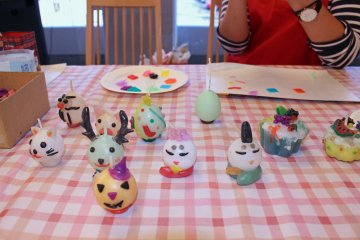 <p>An assortment of candles made by previous participants</p>