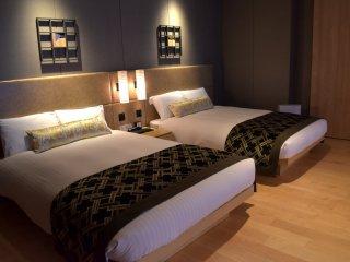 一つのベッドが二人で寝られる広さだ