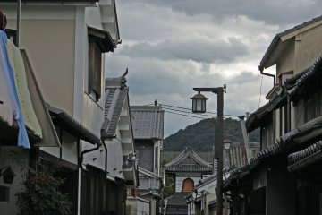<p>The tower of a Meiji-era temple at the end of a narrow street &nbsp;</p>