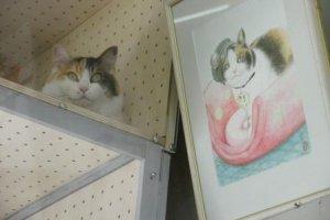 Nitama with portrait of Tama