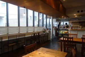The long counter near the front of the shop gives diners a view over the street below
