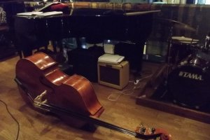 A big old double bass waiting to be stood up and slapped