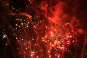 Fireworks color the night sky
