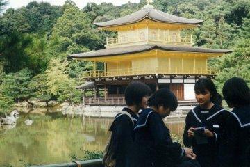 Schoolgirls by the temple