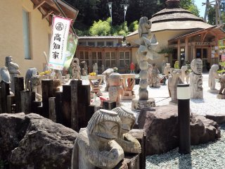 In front of the museum are hand-carved kappa (and various other creations) in all shapes, sizes and positions.