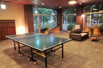 <p>Just off the lobby is a recreation space containing a ping pong table.</p>