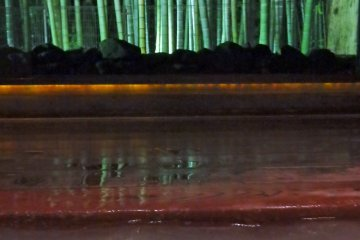 <p>The gorgeous view of a lit-up bamboo forest from the Kaguya bath.</p>