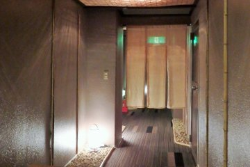 <p>A hallway that leads to the private baths.</p>