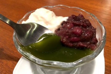 <p>Dessert was delicious matcha jelly topped with red beans and tofu cream. Chef does not use any dairy products to reduce allerge.</p>