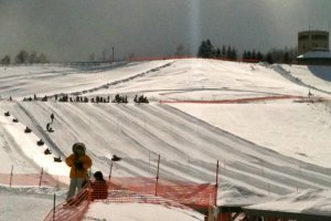 Tube-sledding at Takino Snow World