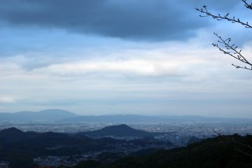 <p>The view of the Yamato Basin and the cities of Kashihara and Yamato Takada from the standing Buddha. On a clear day one can see as far north as Nara City.</p>
