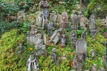 There are hundreds of small stone Buddhas along the hills . . .