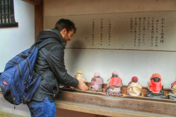 Choose a Buddha statue and try to lift it