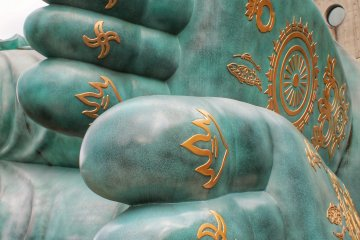The holy teachings on the statue's soles