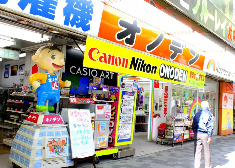 <p>The store&#39;s front looks so inviting with its posters and display in vibrant colors</p>