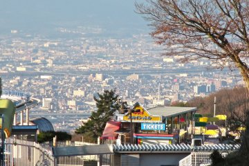 <p>The view of northern Osaka creates a stunning backdrop for the amusement park</p>