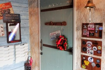 <p>Once inside, go through this door to enter the cafe.</p>
