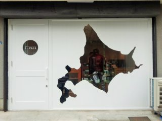 The front of the shop with a cut-out of Hokkaido, where all the cheese here comes from