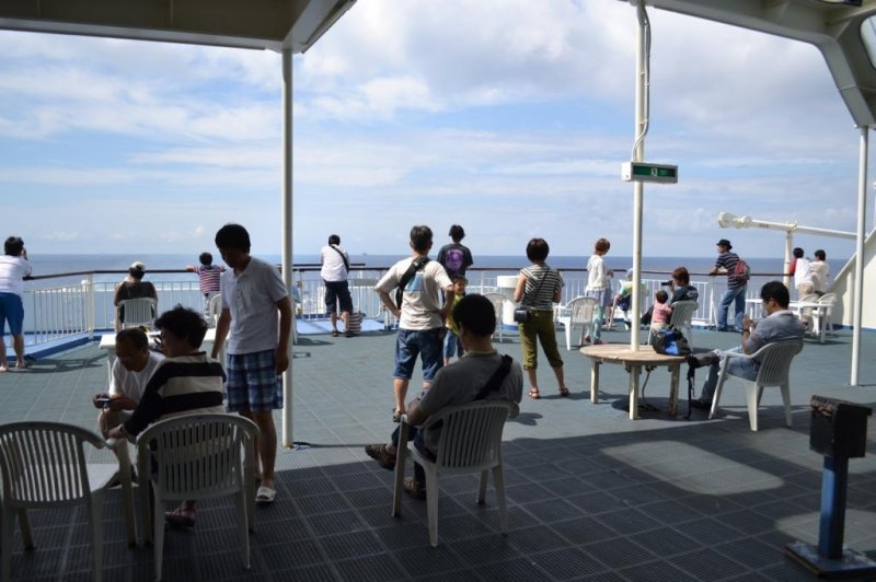 Passengers relax on the rear deck