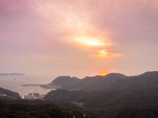 The sun setting over the horizon