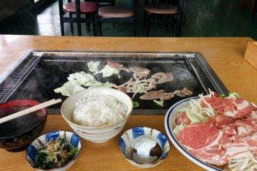 <p>Enjoying delcious grilled lamb at the restaurant</p>