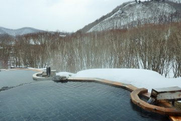 Guests staying overnight can enjoy this amazing open air bath.