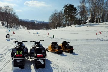 Thrill seekers can speed around this snowmobiling course.