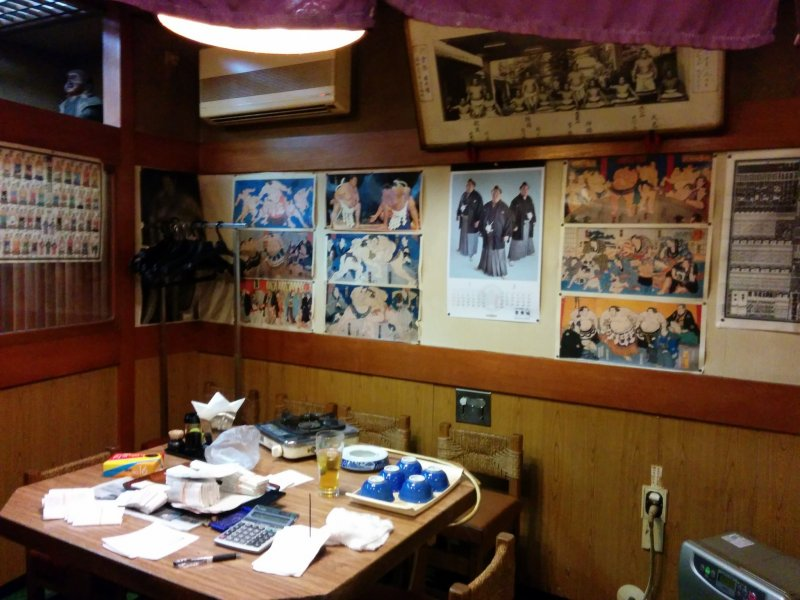 Tons of sumo pics and info decorate the interior