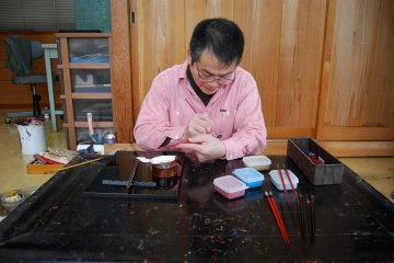Watching Hayashi-san paint a tiny decorate symbol on lacquerware chopsticks is an honour.