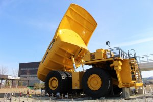 The dump truck stands over seven meters tall