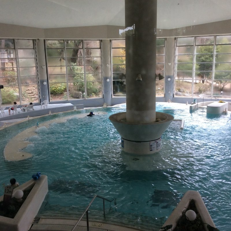 Tent-like architecture, with a huge pillar extending from the center of the main pool to the ceiling (left)