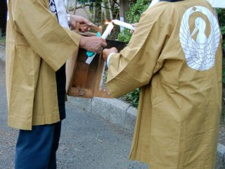 Following a ceremony in the shrine, participants lit the lanterns