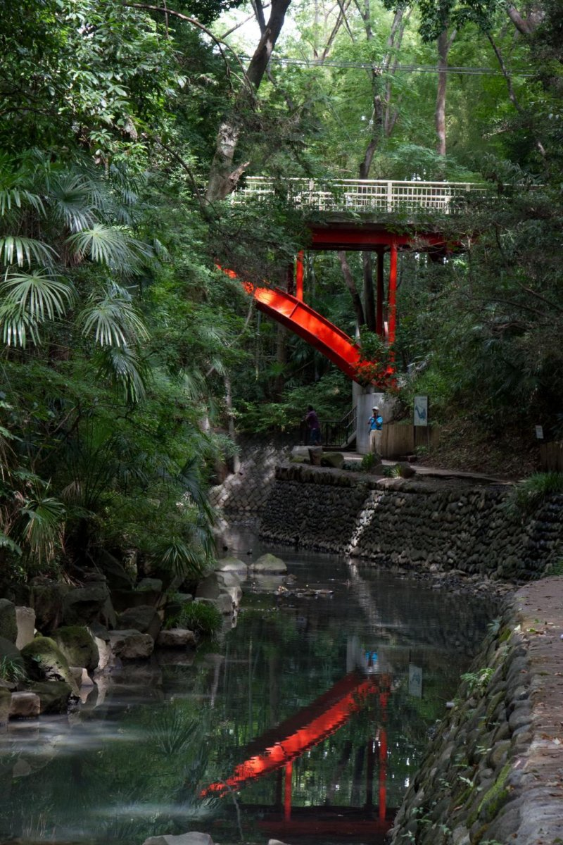 A bright red bridge marks the beginning of the walk