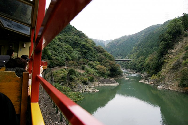 <p>The Sagano Romance Train, a sight-seeing tram that winds its way to Kameoka</p>