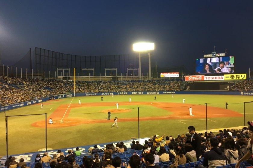 Tokyo Yakult Swallows versus the Hanshin Tigers at Meiji Jingu Stadium.