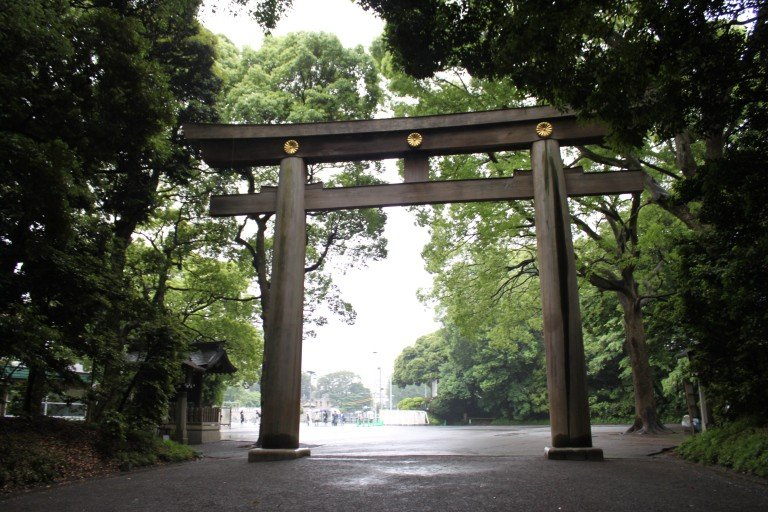 The torii gate at the entrance of Meiji Shrine, marking the entrance to a peaceful oasis.