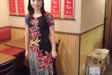 <p>The waitress in her colorful Vietnamese dress</p>