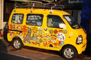 The yellow van parked outside Cafe Konichiwa