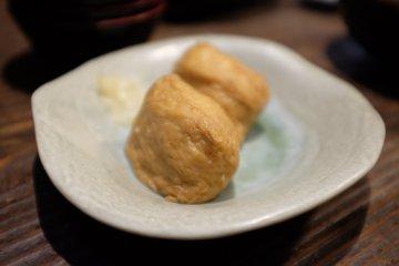 Inari sushi (sushi rice is stuffed in seasoned Aburaage tofu pouches)
