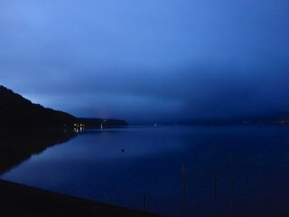 Darkest before dawn, a blanket of clouds hangs low over the lake at around 4:00 am