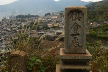 <p>On the climb up to the temple, I got lost in a cemetery with rust-coloured graves</p>