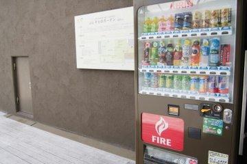 A vending machine near the entrance to the garden