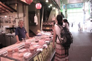 Visitors explore the Omi-cho market
